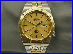 80's vintage watch SEIKO SQ sports 100 Ref. 8229-8010 gold and SS 38mm royal oak